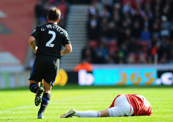 Gary Neville of Manchester United leaves Matthew Etherington of Stoke in a heap during the Barclays Premier League match between Stoke City and Manchester United at Britannia Stadium on October 24, 2010 in Stoke on Trent, England.