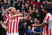 Marko Arnautovic of Stoke City (L) celebrates scoring his sides first goal with Glen Johnson of Stoke City (R) during the Premier League match between Stoke City and Middlesbrough at Bet365 Stadium on March 4, 2017 in Stoke on Trent, England.