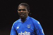 Kanu of Portsmouth trudges off in the wind and rain after losing the Barclays Premier League match between Stoke City and Portsmouth at The Britannia Stadium on November 22, 2009 in Stoke on Trent, England.