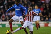 Kanu of Portsmouth battles with Salif Diao of Stoke City during the Barclays Premier League match between Stoke City and Portsmouth at The Britannia Stadium on November 22, 2009 in Stoke on Trent, England.