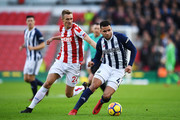 Hal Robson-Kanu of est Bromwich Albion is put under pressure by Darren Fletcher of Stoke City during the Premier League match between Stoke City and West Bromwich Albion at Bet365 Stadium on December 23, 2017 in Stoke on Trent, England.