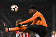 Glen Johnson of Stoke City and Kortney Hause of Wolverhampton Wanderers in atcion during The Emirates FA Cup Third Round match between Stoke City and Wolverhampton Wanderers at Bet365 Stadium on January 7, 2017 in Stoke on Trent, England.