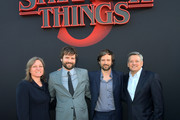 """(L-R) Cindy Holland, Ross Duffer, Matt Duffer and Ted Sarandos, Chief Content Officer for Netflix attend the """"Stranger Things"""" Season 3 World Premiere on June 28, 2019 in Santa Monica, California."""
