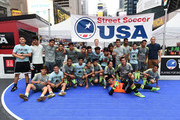 American soccer player Dax McCarty poses with the teams during the Street Soccer USA Cup at Times Square on July 9, 2016 in New York City.