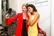 Lisa Banholzer and Marie Nasemann attend the Strenesse X Styleshiver X Bloggerbazaar launch event on August 2, 2018 in Berlin, Germany.