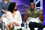 "Madeleine Mantock (L) and Ser'Darius Blain from ""Charmed"" speak onstage at the CW Network portion of the Summer 2018 TCA Press Tour at The Beverly Hilton Hotel on August 6, 2018 in Beverly Hills, California."
