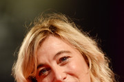 """Valeria Bruni Tedeschi walks the red carpet ahead of the """"The Summer House (Les Estivants)"""" screening during the 75th Venice Film Festival at Sala Grande on September 5, 2018 in Venice, Italy."""