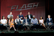 "(Top L-R) Chief Creative Officer of DC Entertainment Geoff Johns, producers Greg Berlanti and Andrew Kreisberg, and (Bottom L-R) actors Carlos Valdes, Danielle Panabaker, Tom Cavanagh, Grant Gustin, Jesse L. Martin, Candice Patton, and Rick Cosnett speak onstage at the ""The Flash"" panel during the El Rey Network portion of the 2014 Summer Television Critics Association at The Beverly Hilton Hotel on July 18, 2014 in Beverly Hills, California."