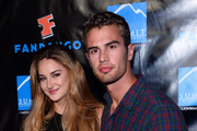 Actress Shailene Woodley (L) and actor Theo James arrive at Summit Entertainment's press event for the movies 'Ender's Game' and 'Divergent' at the Hard Rock Hotel San Diego on July 18, 2013 in San Diego, California.