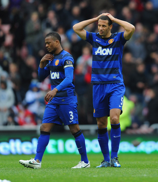 Patrice Evra and Rio Ferdinand of Manchester United look dejected after the Barclays Premier League match between Sunderland and Manchester United at the Stadium of Light on May 13, 2012 in Sunderland, England.