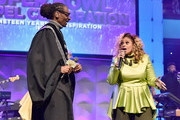 Snoop Dogg (L) and Dorinda Clark-Cole perform onstage during BET Presents 19th Annual Super Bowl Gospel Celebration at Bethel University on February 1, 2018 in St Paul, Minnesota.