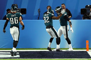 Nick Foles #9 of the Philadelphia Eagles celebrates his 1 yard touchdown reception with Torrey Smith #82 and Zach Ertz #86 of the Philadelphia Eagles against the New England Patriots during the second quarter in Super Bowl LII at U.S. Bank Stadium on February 4, 2018 in Minneapolis, Minnesota.