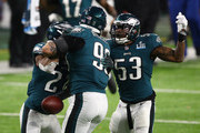 Derek Barnett #96 of the Philadelphia Eagles celebrates recovering a fumble with Patrick Robinson #21 and Nigel Bradham #53 during the fourth quarter against the New England Patriots in Super Bowl LII at U.S. Bank Stadium on February 4, 2018 in Minneapolis, Minnesota.