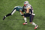 Danny Amendola #80 of the New England Patriots is tackled by Patrick Robinson #21 of the Philadelphia Eagles during the second quarter in Super Bowl LII at U.S. Bank Stadium on February 4, 2018 in Minneapolis, Minnesota.