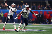 Tom Brady #12 of the New England Patriots makes a pass during Super Bowl LIII against the Los Angeles Rams at Mercedes-Benz Stadium on February 03, 2019 in Atlanta, Georgia.