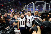 Tom Brady #12 of the New England Patriots and Julian Edelman #11 of the New England Patriots celebrate after Super Bowl LIII at Mercedes-Benz Stadium on February 03, 2019 in Atlanta, Georgia.