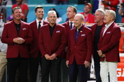 Dan Marino, Tom Brady, Joe Montana, Peyton Manning, Roger Staubach, Brett Favre and John Elway of the NLF 100 All-Time Team are honored on the field prior to Super Bowl LIV between the San Francisco 49ers and the Kansas City Chiefs at Hard Rock Stadium on February 02, 2020 in Miami, Florida.