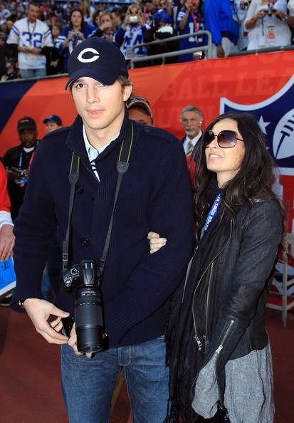 Actors Ashton Kutcher and Demi Moore pose on the sidelines prior to Super Bowl XLIV between the Indianapolis Colts and the New Orleans Saints on February 7, 2010 at Sun Life Stadium in Miami Gardens, Florida.
