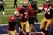 (L-R) Frank Gore #21, Colin Kaepernick #7  and Joe Staley #74 of the San Francisco 49ers celebrate after Gore scored a 6-yard rushing touchdown in the third quarter against the Baltimore Ravens during Super Bowl XLVII at the Mercedes-Benz Superdome on February 3, 2013 in New Orleans, Louisiana.