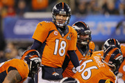 Quarterback Peyton Manning #18 of the Denver Broncos talks with teammates during the second quarter against the Seattle Seahawks  during Super Bowl XLVIII at MetLife Stadium on February 2, 2014 in East Rutherford, New Jersey.
