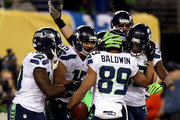 Wide receiver Doug Baldwin #89 of the Seattle Seahawks celebrates his 10-yard touchdown in the fourth quarter against the Denver Broncos during Super Bowl XLVIII at MetLife Stadium on February 2, 2014 in East Rutherford, New Jersey.