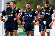 Lima Sopoaga (L) Ben Smith,  Ash Dixon, Aaron Smith and Elliot Dixon look on during the Super Rugby trial match between the Highlanders and the Crusaders at Fred Booth Park on February 15, 2018 in Waimumu, New Zealand.