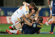 Michael Fitzgerald of the Chiefs fights with Brendon Edmonds of the Highlanders during the Super Rugby Qualifying Final match between the Highlanders and the Chiefs at Forsyth Barr Stadium on June 20, 2015 in Dunedin, New Zealand.