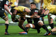 Jeff Toomaga-Allen of the Hurricanes is tackled by Liam Messam of the Chiefs during the Super Rugby Qualifying Final match between the Hurricanes and the Chiefs at Westpac Stadium on July 20, 2018 in Wellington, New Zealand.