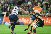 Lopeti Timani of the Rebels is challenged by Michael Fitzgerald of the Chiefs  during the round 12 Super Rugby match between the Rebels and the Chiefs at AAMI Park on May 2, 2015 in Melbourne, Australia.