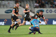Bryn Gatland of the Blues tackles Liam Messam of the Chiefs during the round two Super Rugby match between the Blues and the Chiefs at Eden Park on March 2, 2018 in Auckland, New Zealand.