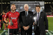 (L-R) Kieran Read, David Rhodes, vice president of New Zealand Rugby and Richie McCaw pose with their IRB Awards after the round four Super Rugby match between the Crusaders and the Stormers at AMI Stadium on March 8, 2014 in Christchurch, New Zealand.