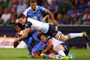 Marcel Brache of the Force gets tackled by Jack Dempsey and Andrew Kellaway of the Waratahs during the round nine Super Rugby match between the Force and the Waratahs at nib Stadium on April 23, 2016 in Perth, Australia.