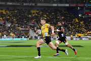 Jordie Barrett of the Hurricanes evades Liam Messam of the Chiefs during the round nine Super Rugby match between the Hurricanes and the Chiefs at Westpac Stadium on April 13, 2018 in Wellington, New Zealand.