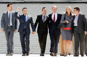 Members of the plaintiff team in the same sex marriage cases before the Supreme Court (L-R) Adam Umhoefer, executive director of the American Foundation for Equal Rights, plaintiff Paul Katami, plaintiff Jeff Zarillo, attorney David Boies, plaintiff Kris Perry and plaintiff Sandy Stier wave from the court's steps after favorable rulings were issued June 26, 2013 in Washington, DC. The high court ruled to strike down DOMA and determined the California's proposition 8 ban on same-sex marriage was not properly before them, declining to overturn the lower court's striking down of the law.