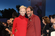 Luca Guadagnino and Tilda Swinton walk the red carpet ahead of the 'Suspiria' screening during the 75th Venice Film Festival at Sala Grande on September 1, 2018 in Venice, Italy.