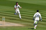 Hilton Cartwright of Middlesex celebrates with wicketkeeper John Simpson fter catching Luke Wright of Sussex first ball off his own bowling during the Specsavers County Championship Division Two match between Sussex and Middlesex at The 1st Central County Ground on May 7, 2018 in Hove, England.
