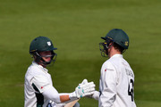 Alexei Kervezee of Worcestershire congratulates team mate Richard Oliver on reaching his century during the LV County Championship match between Sussex and Gloucestershire at BrightonandHoveJobs.com County Ground on April 20, 2015 in Hove, England.