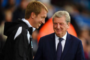 Graham Potter, Manager of Swansea City greets Roy Hodgson, Manager of Crystal Palace prior to the Carabao Cup Second Round match between Swansea City and Crystal Palace at Liberty Stadium on August 28, 2018 in Swansea, Wales.
