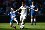 Stephen Ireland of Stoke City and Alfie Mawson of Swansea City battle for possession during the Premier League match between Swansea City and Stoke City at Liberty Stadium on May 13, 2018 in Swansea, Wales.