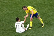 Gustav Svensson of Sweden consoles Hwang Hee-chan of Korea Republic following the 2018 FIFA World Cup Russia group F match between Sweden and Korea Republic at Nizhniy Novgorod Stadium on June 18, 2018 in Nizhniy Novgorod, Russia.