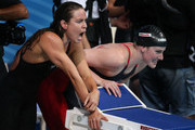 Natalie Coughlin (L) and Missy Franklin of the USA cheer on their teammate during the Swimming Women's4x100mFreestyle on day nine of the 15th FINA World Championships at Palau Sant Jordi on July 28, 2013 in Barcelona, Spain.