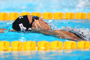 Aya Terakawa of Japan competes during the Women's 100m Backstroke Preliminaries heat three on day ten of the 15th FINA World Championships at Palau Sant Jordi on July 29, 2013 in Barcelona, Spain.