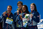 (L-R) Gold medallists Ryan Lochte, Nathan Adrian, Simone Manuel and Missy Franklin of the United States pose during the medal ceremony after setting a new world record of 3:23.05 in the Mixed 4x100m Freestyle Relay Final on day fifteen of the 16th FINA World Championships at the Kazan Arena on August 8, 2015 in Kazan, Russia.