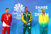 (L-R) Silver medalist James Guy of England, gold medalist Chad le Clos of South Africa and bronze medalist Grant Irvine of Australia pose during the medal ceremony for the Men's 100m Butterfly Final on day five of the Gold Coast 2018 Commonwealth Games at Optus Aquatic Centre on April 9, 2018 on the Gold Coast, Australia.