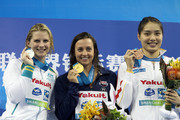 Gold medalist Rebecca Soni (C) of the United States poses with silver medalist Leisel Jones of Australia and bronze medalist Liping Ji of China after the Women's 100m Breaststroke Final during Day Eleven of the 14th FINA World Championships at the Oriental Sports Center on July 26, 2011 in Shanghai, China.