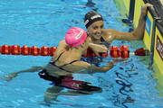 Rebecca Soni (R) of the United States celebrates the gold medal with silver medalist Yuliya Efimova of Russia after the Women's 200m Breaststroke Final during Day Fourteen of the 14th FINA World Championships at the Oriental Sports Center on July 29, 2011 in Shanghai, China.
