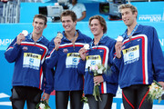 (L-R) Michael Phelps, Nathan Adrian, Ryan Lochte and Mattew Grevers of the United States receive the gold medal during the medal ceremony for the Men's 4x 100m Freestyle Final  during the 13th FINA World Championships at the Stadio del Nuoto on July 26, 2009 in Rome, Italy.