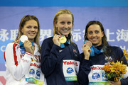 Gold medalist Jessica Hardy (C) of the United States poses with silver medalist Yuliya Efimova of Russia and bronze medalist Rebecca Soni of the United States after the Women's 50m Breaststroke Final during Day Sixteen of the 14th FINA World Championships at the Oriental Sports Center on July 31, 2011 in Shanghai, China.