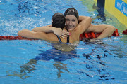 Jessica Hardy (R) of the United States is congratulated by team mate and bronze medalist Rebecca Soni after winning the gold medal in the Women's 50m Breaststroke Final during Day Sixteen of the 14th FINA World Championships at the Oriental Sports Center on July 31, 2011 in Shanghai, China.