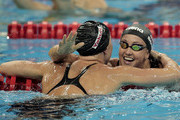 Jessica Hardy (L) of the United States is congratulated by team mate and bronze medalist Rebecca Soni after winning the gold medal in the Women's 50m Breaststroke Final during Day Sixteen of the 14th FINA World Championships at the Oriental Sports Center on July 31, 2011 in Shanghai, China.